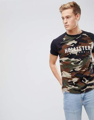 Hollister Raglan Baseball Logo Print T-Shirt in Olive Camo/Black