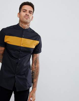 Asos DESIGN skinny cut and sew shirt in mustard with black panel
