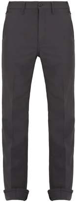 Prada Mid-rise tapered-leg wool trousers