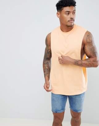 Asos Design DESIGN vest with extreme dropped armhole in orange