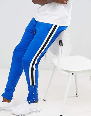 Asos DESIGN skinny retro track joggers in blue with side stripe and popper hem