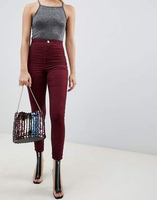Asos DESIGN Rivington high waisted cord jeggings in oxblood