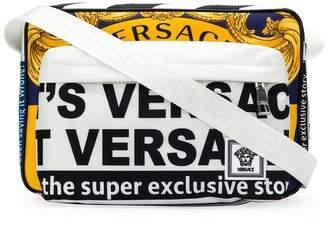 Versace news print messenger bag