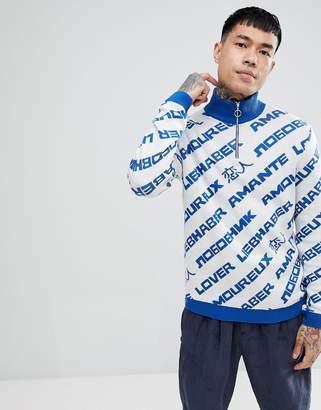 Asos DESIGN turtleneck slogan sweater with zip in blue