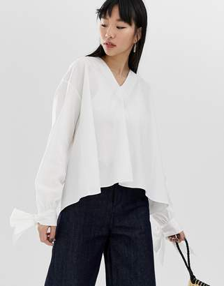 Asos Design DESIGN long sleeve oversized top with tie cuff in cotton
