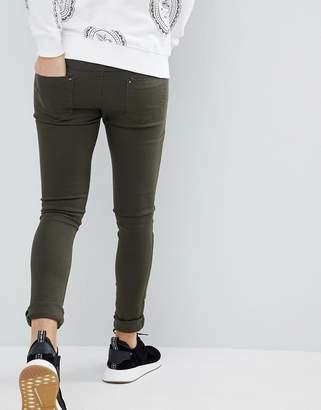 Criminal Damage Super Skinny Jeans in Olive