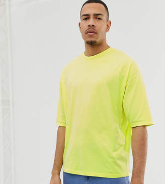 Asos DESIGN Tall oversized t-shirt with half sleeve in washed neon yellow