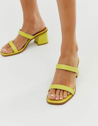 Asos Design DESIGN High Class leather block heeled mid mules in yellow