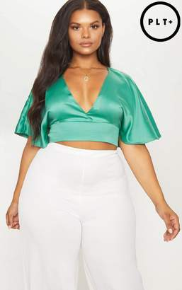 PrettyLittleThing Plus Green Satin Flare Plunge Crop Top