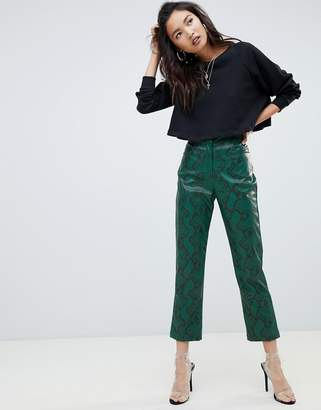 NA-KD faux leather snake print pants in green