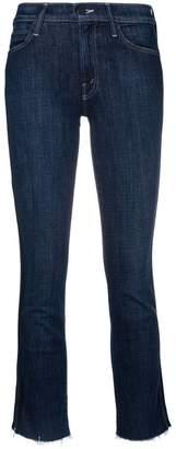 Mother side stripe raw hem skinny jeans