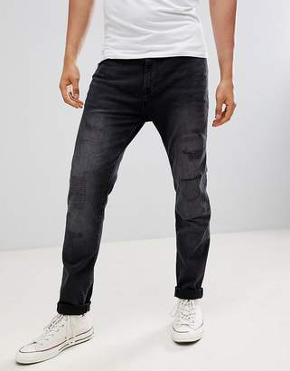 Burton Menswear Tapered Jeans With Abrasions In Black Wash
