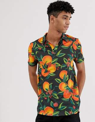 Asos DESIGN polo with all over floral fruit print and revere collar