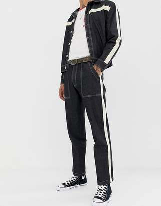 Sacred Hawk tapered jeans with side stripe