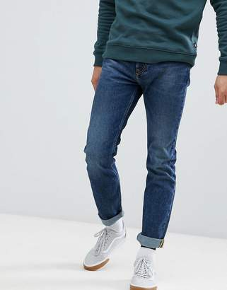 Lee Rider Slim Jeans in Blue Storm in Mid Wash