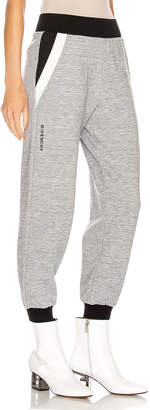 Givenchy Cropped Jogger Pant in Heather Grey | FWRD