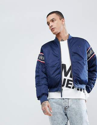 Tommy Jeans Reversible Mesh Padded Bomber Jacket Sleeve Band Logo in Navy