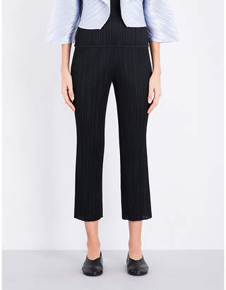 Pleats Please Issey Miyake Cropped slim pleated trousers