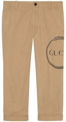 Gucci Ouroboros print chino trousers