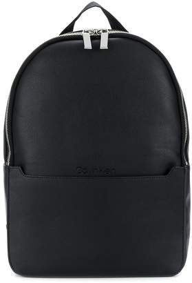 Round faux-leather backpack