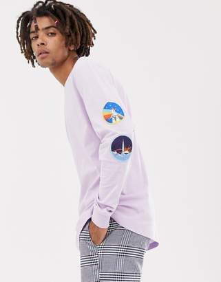 Asos Design DESIGN NASA relaxed long sleeve t-shirt with sleeve patches and back print
