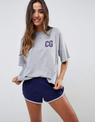 Asos DESIGN His & Hers couple goals boxy tee and short set