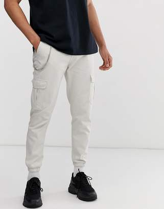 cargo trousers with chain detail in stone