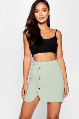 boohoo Petite Mock Horn Button Curved Hem Wrap Mini Skirt