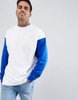 Asos DESIGN oversized longline sweatshirt in white with contrast sleeves