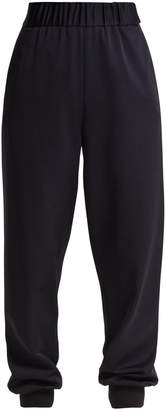 Tibi Sculpted elasticated-waist piqué trousers