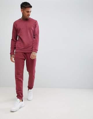 Asos DESIGN tracksuit sweatshirt/skinny joggers in burgundy marl