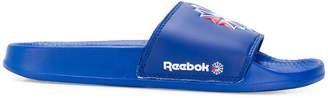 Reebok logo slides