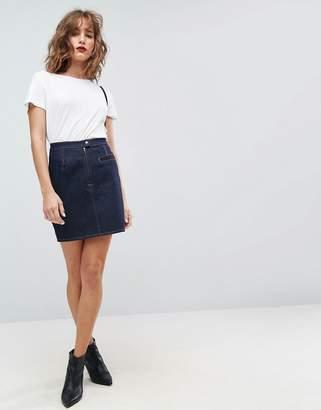 Asos DESIGN denim mini skirt in indigo with tobacco threads