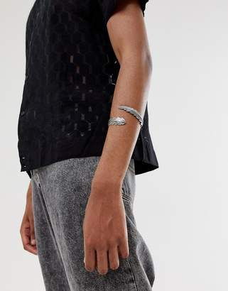 Asos DESIGN feather bangle in burnished silver tone