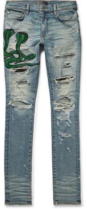 Amiri Thrasher Skinny-Fit Appliquéd Distressed Stretch-Denim Jeans