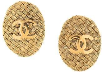 Chanel Pre-Owned embossed logo oval earrings