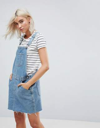 Asos Design DESIGN denim dungaree dress in midwash blue