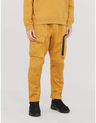 Nike Belted relaxed-fit tapered canvas cargo trousers