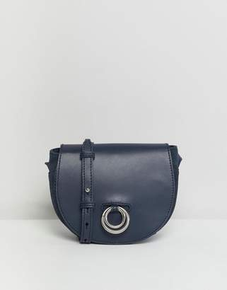 Asos DESIGN leather and suede saddle bag with ring detail