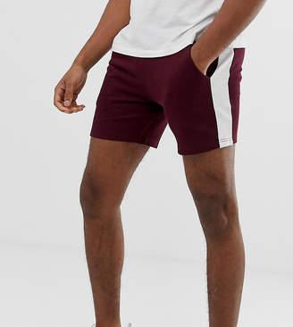 Asos Design DESIGN Tall jersey skinny shorts in shorter length with side stripe in burgundy