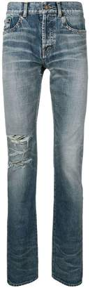 Saint Laurent ripped stonewashed high rise jeans