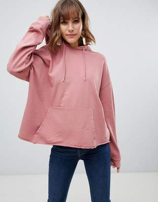 Asos DESIGN oversized hoodie with raw hem in wash