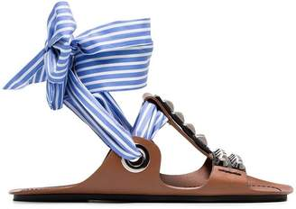 Prada Brown gladiator sandals with studs and black ribbon and a blue and white striped ribbon