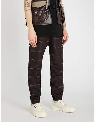 b661a0e52ab5 A-Cold-Wall  Logo-print relaxed-fit tapered shell jogging bottoms