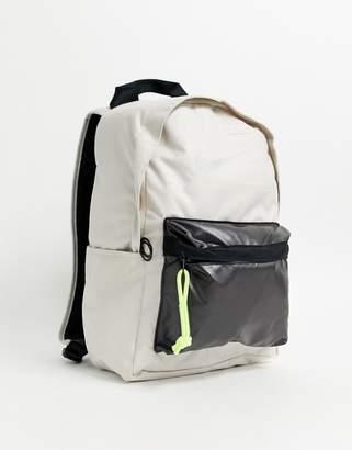 Nike Elemental winterized backpack in beige with neon zip