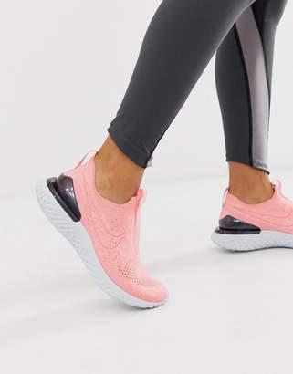 Nike Running epic react flyknit slip on sneakers in pink
