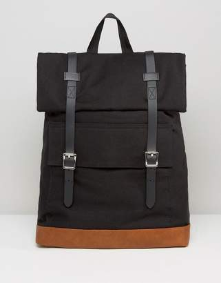 Asos DESIGN Backpack In Canvas With Long Buckle Straps