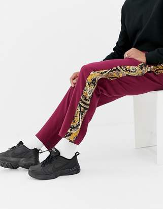 Asos DESIGN relaxed pants with paisley side poppers