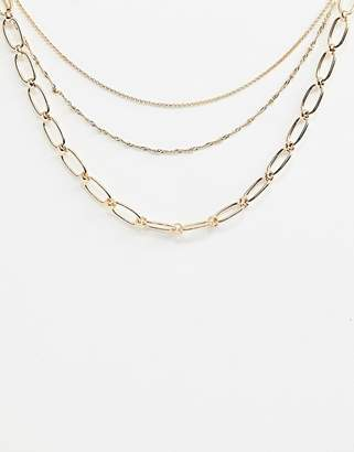 Asos Design DESIGN multirow necklace with open link and dot dash chain in gold