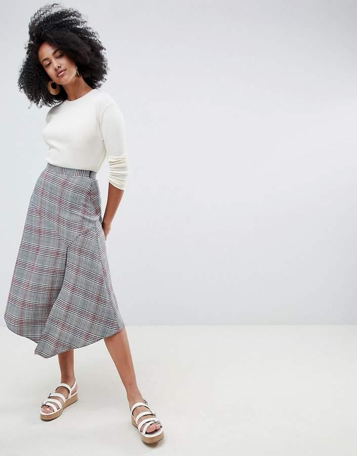 ASOS DESIGN houndstooth print midi skirt with asymmetric hanky hem